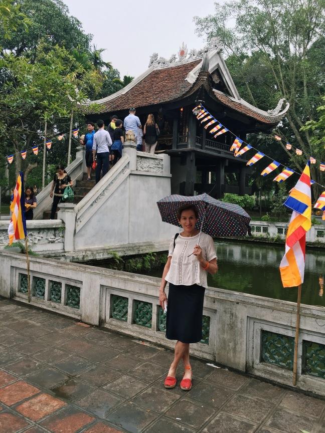 Travel savvy mother in Hanoi at the One Pillar Pagoda.